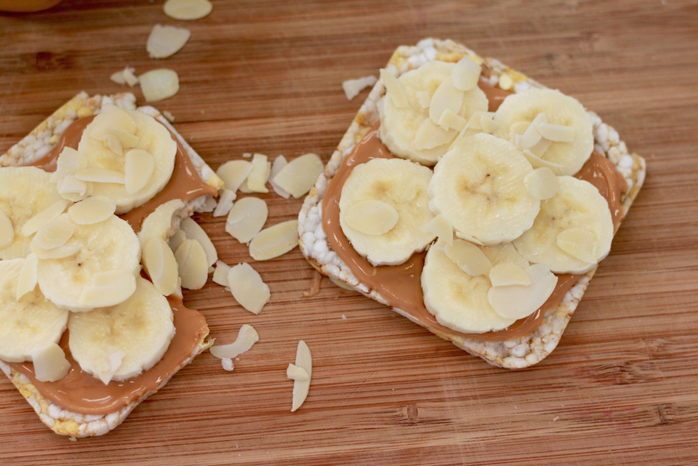 peanut butter, banana and almond flakes
